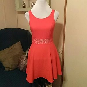 Pretty red skater dress with lace inset at waist